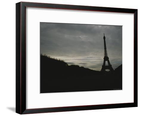 The Eiffel Tower Silhouetted against a Gray, Cloud-Filled Sky-Raul Touzon-Framed Art Print