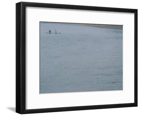 A Bicyclist is Ferried Across the Li River on a Narrow Raft-Raul Touzon-Framed Art Print