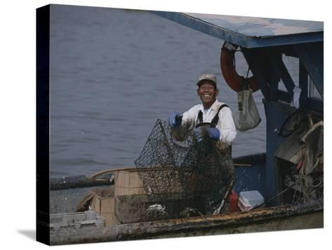 Smiling Fisherman on a Crab Boat-Medford Taylor-Stretched Canvas Print
