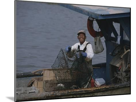 Smiling Fisherman on a Crab Boat-Medford Taylor-Mounted Photographic Print