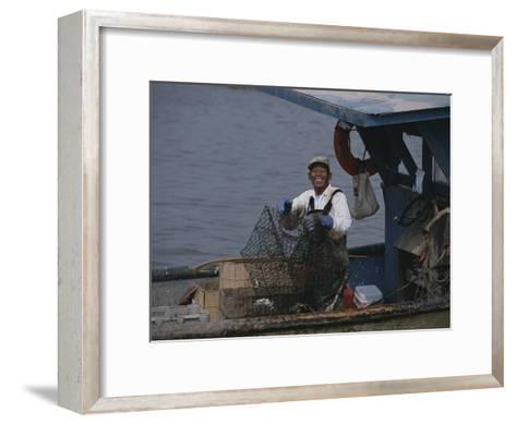 Smiling Fisherman on a Crab Boat-Medford Taylor-Framed Art Print