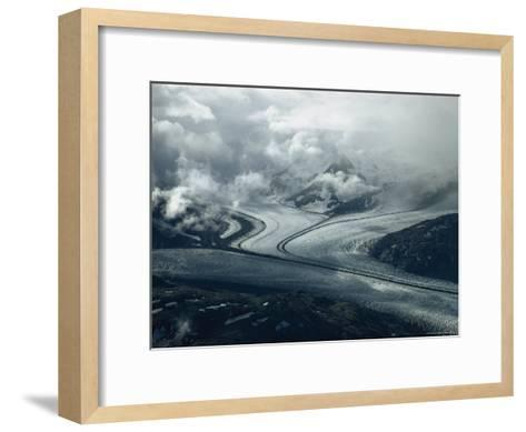 Branches of a Glacier Join Together Below Cloud-Covered Peaks-George F^ Mobley-Framed Art Print