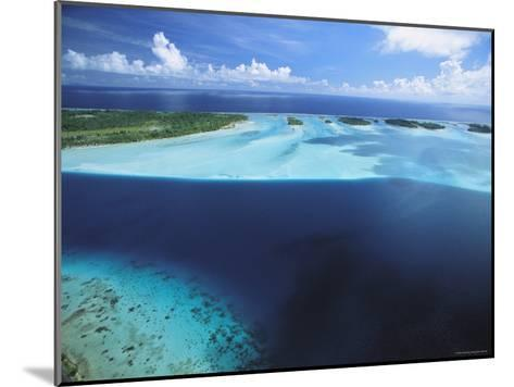 Clear Blue Water Surrounds Small Pacific Islands-Tim Laman-Mounted Photographic Print