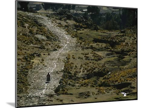 A Bolivian Woman Walks Along the Ancient Road to Tiwanaku--Mounted Photographic Print
