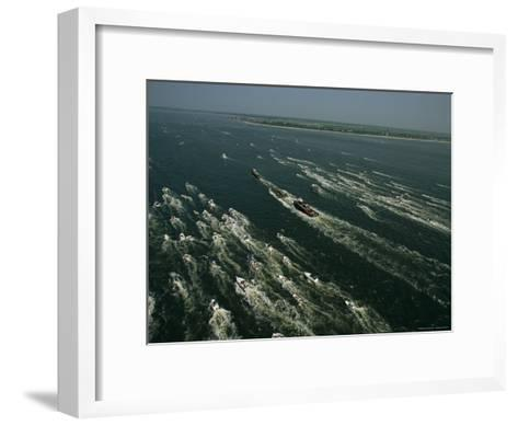 The Raised Hunley Submarine Escorted Ashore by Boats of Well-Wishers-Ira Block-Framed Art Print