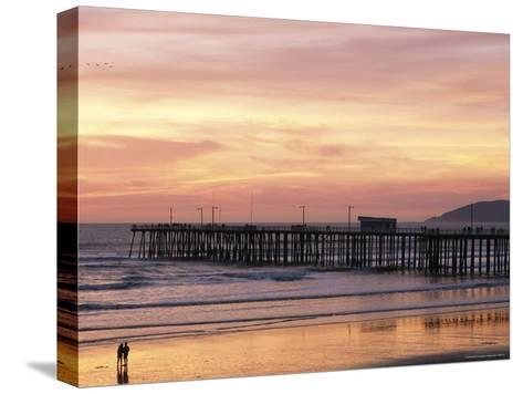A Silhouetted Couple Strolling the Beach at Sunset-Michael S^ Lewis-Stretched Canvas Print