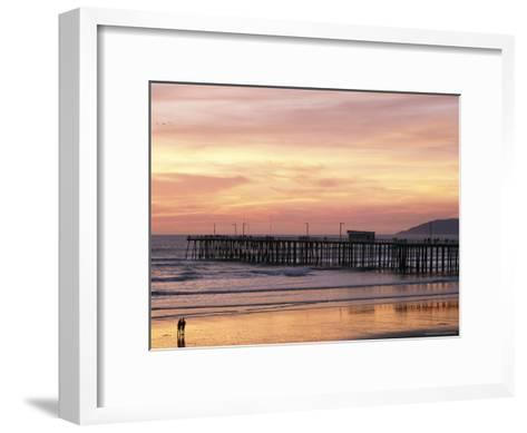 A Silhouetted Couple Strolling the Beach at Sunset-Michael S^ Lewis-Framed Art Print