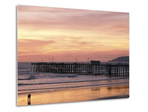 A Silhouetted Couple Strolling the Beach at Sunset-Michael S^ Lewis-Metal Print