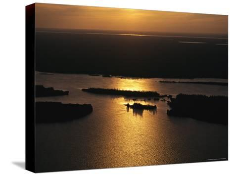 Sunset is Reflected on the Rippling Water of Great Slave Lake-Raymond Gehman-Stretched Canvas Print
