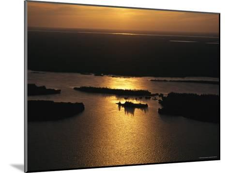 Sunset is Reflected on the Rippling Water of Great Slave Lake-Raymond Gehman-Mounted Photographic Print