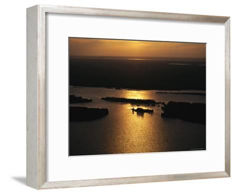 Sunset is Reflected on the Rippling Water of Great Slave Lake-Raymond Gehman-Framed Art Print