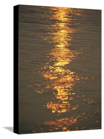 The Sunset Casts an Orange Hue on the Mackenzie River-Raymond Gehman-Stretched Canvas Print