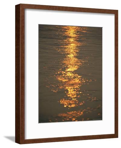 The Sunset Casts an Orange Hue on the Mackenzie River-Raymond Gehman-Framed Art Print