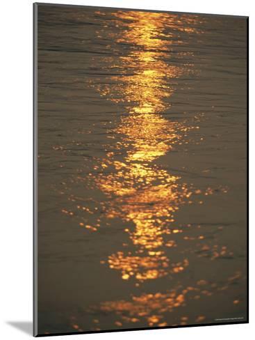 The Sunset Casts an Orange Hue on the Mackenzie River-Raymond Gehman-Mounted Photographic Print