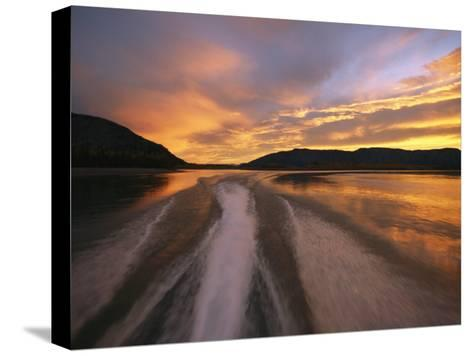 A Jet Boat Leaves a Wake in the Mackenzie River at Sunset-Raymond Gehman-Stretched Canvas Print