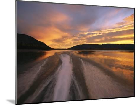 A Jet Boat Leaves a Wake in the Mackenzie River at Sunset-Raymond Gehman-Mounted Photographic Print