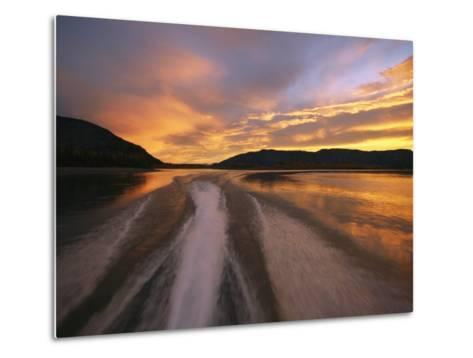 A Jet Boat Leaves a Wake in the Mackenzie River at Sunset-Raymond Gehman-Metal Print