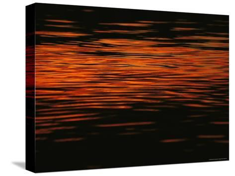Sunset is Reflected in the Mackenzie River-Raymond Gehman-Stretched Canvas Print