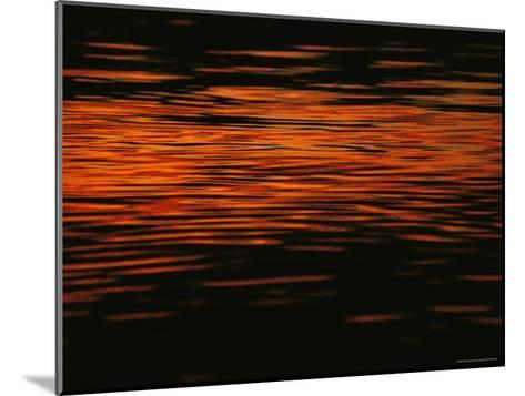 Sunset is Reflected in the Mackenzie River-Raymond Gehman-Mounted Photographic Print
