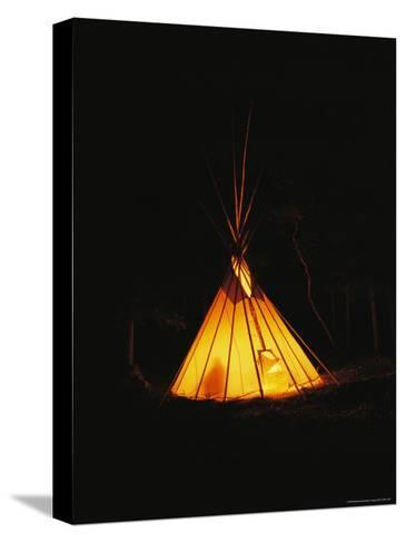 The Glow from a Campfire Makes a Shadow on a Tepee-Raymond Gehman-Stretched Canvas Print