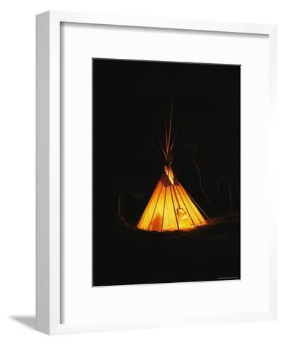 The Glow from a Campfire Makes a Shadow on a Tepee-Raymond Gehman-Framed Art Print