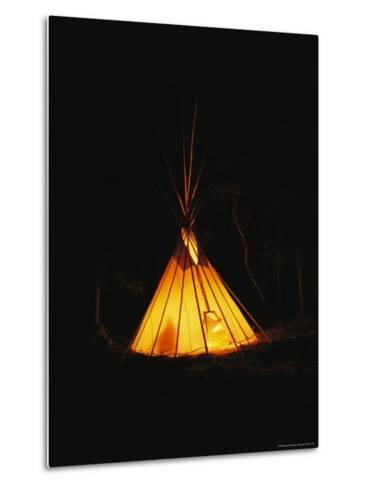 The Glow from a Campfire Makes a Shadow on a Tepee-Raymond Gehman-Metal Print