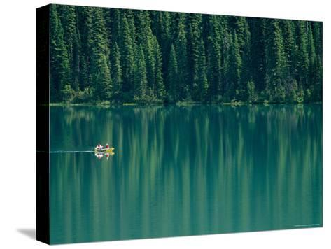 Canoeing on Still Water of Yoho National Parks Emerald Lake-Michael Melford-Stretched Canvas Print