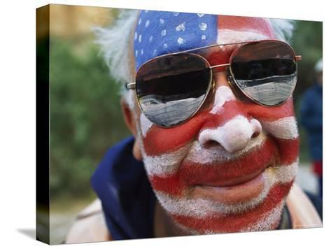 An American Flag is Painted on Mans Face in Arizona-David Edwards-Stretched Canvas Print