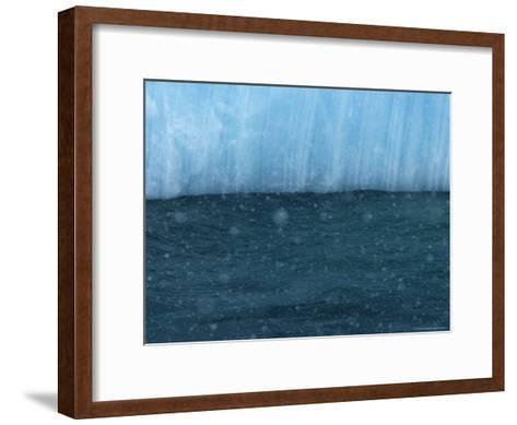 Snow Flakes Drifting Past a Blue Iceberg-Ralph Lee Hopkins-Framed Art Print