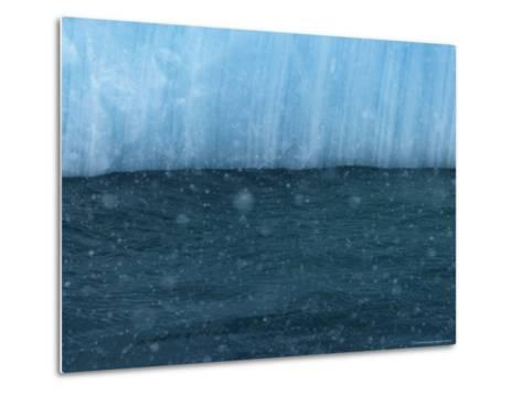 Snow Flakes Drifting Past a Blue Iceberg-Ralph Lee Hopkins-Metal Print