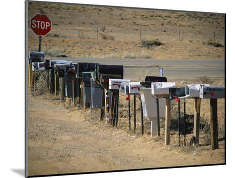A Parade of Mailboxes on the Outskirts of Santa Fe-Stephen St^ John-Mounted Photographic Print