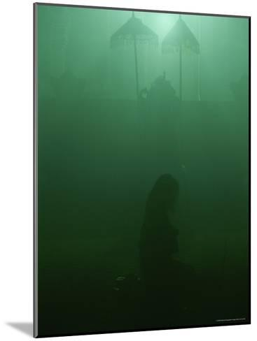 A Woman Praying in a Temple-Peter Carsten-Mounted Photographic Print