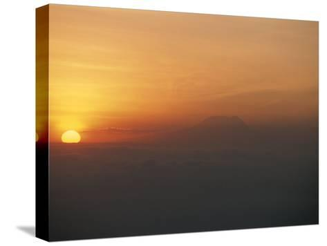 Sun Sets over Mount Kilimanjaro, Seen from Ol Doinyo Lengai Volcano-Peter Carsten-Stretched Canvas Print