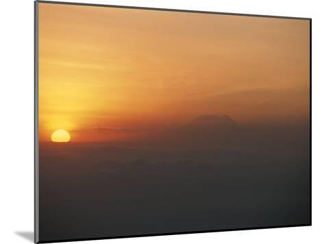Sun Sets over Mount Kilimanjaro, Seen from Ol Doinyo Lengai Volcano-Peter Carsten-Mounted Photographic Print