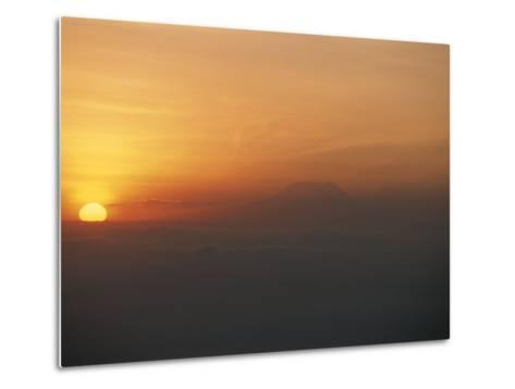 Sun Sets over Mount Kilimanjaro, Seen from Ol Doinyo Lengai Volcano-Peter Carsten-Metal Print