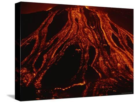 Molten Lava Flows Down a Volcanic Slope-Peter Carsten-Stretched Canvas Print