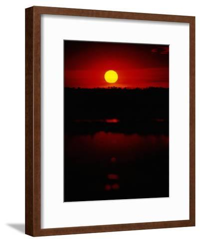 The Setting Sun Creates Reflections on the Waters of Big Cypress Swamp-Raymond Gehman-Framed Art Print