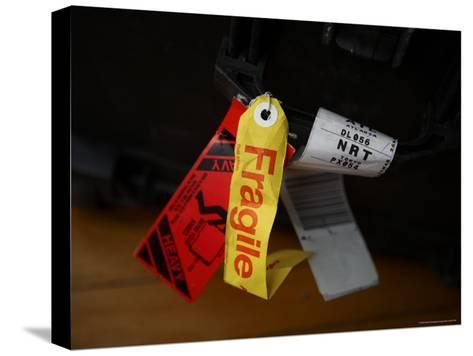 A Fragile Tag is Shown Hanging on a Piece of Baggage-Stephen Alvarez-Stretched Canvas Print