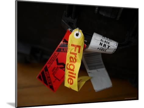 A Fragile Tag is Shown Hanging on a Piece of Baggage-Stephen Alvarez-Mounted Photographic Print
