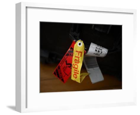 A Fragile Tag is Shown Hanging on a Piece of Baggage-Stephen Alvarez-Framed Art Print