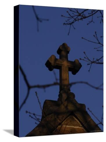 A Stone Cross Caps the Top of a Building-Stephen Alvarez-Stretched Canvas Print