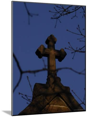 A Stone Cross Caps the Top of a Building-Stephen Alvarez-Mounted Photographic Print