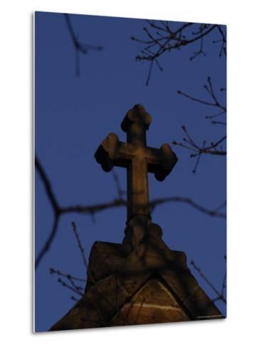 A Stone Cross Caps the Top of a Building-Stephen Alvarez-Metal Print