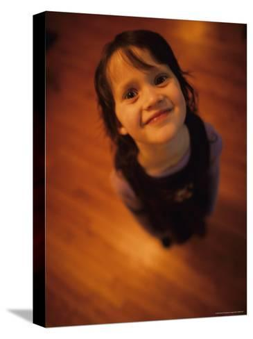 A Little Girl Looks up and Smiles-Stephen Alvarez-Stretched Canvas Print