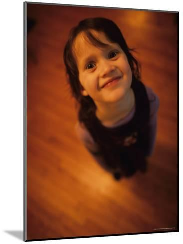 A Little Girl Looks up and Smiles-Stephen Alvarez-Mounted Photographic Print