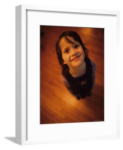 A Little Girl Looks up and Smiles-Stephen Alvarez-Framed Art Print