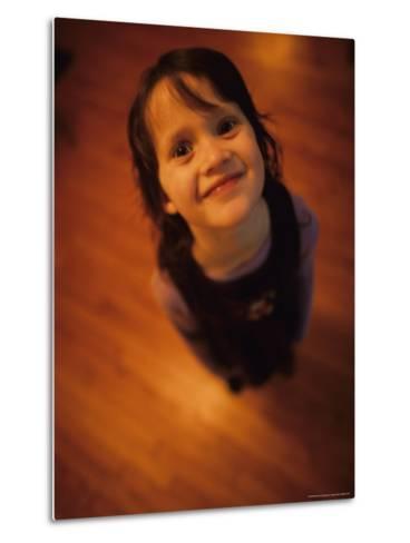 A Little Girl Looks up and Smiles-Stephen Alvarez-Metal Print