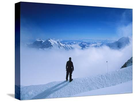 A Climber at 16,000 Feet on the West Buttress of Denali-Bill Hatcher-Stretched Canvas Print