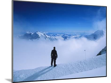 A Climber at 16,000 Feet on the West Buttress of Denali-Bill Hatcher-Mounted Photographic Print