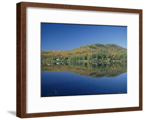 A Lake Surrounded by Trees Displaying the Colors of Autumn-Richard Nowitz-Framed Art Print
